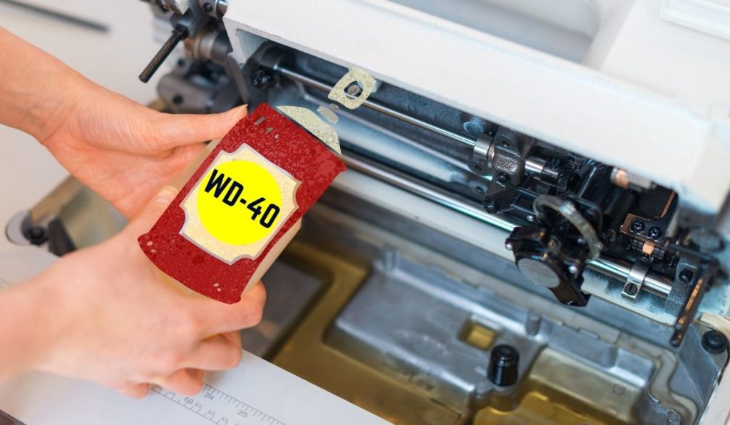 Applying WD-40 to Sewing Machine